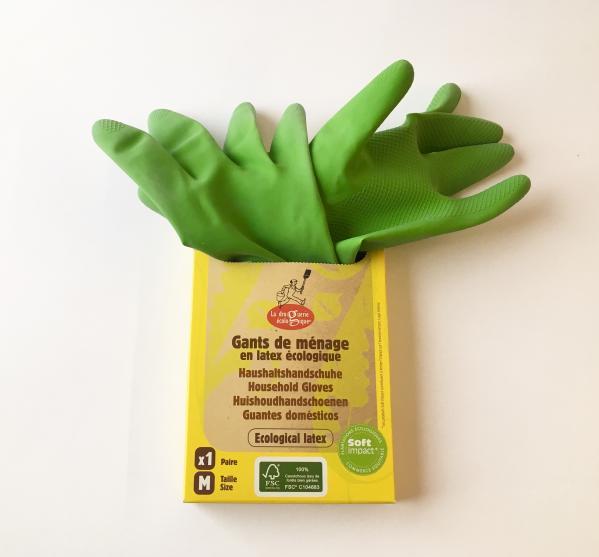 Grüne Gummihandschuhe schauen aus einer Pappschachtel heraus